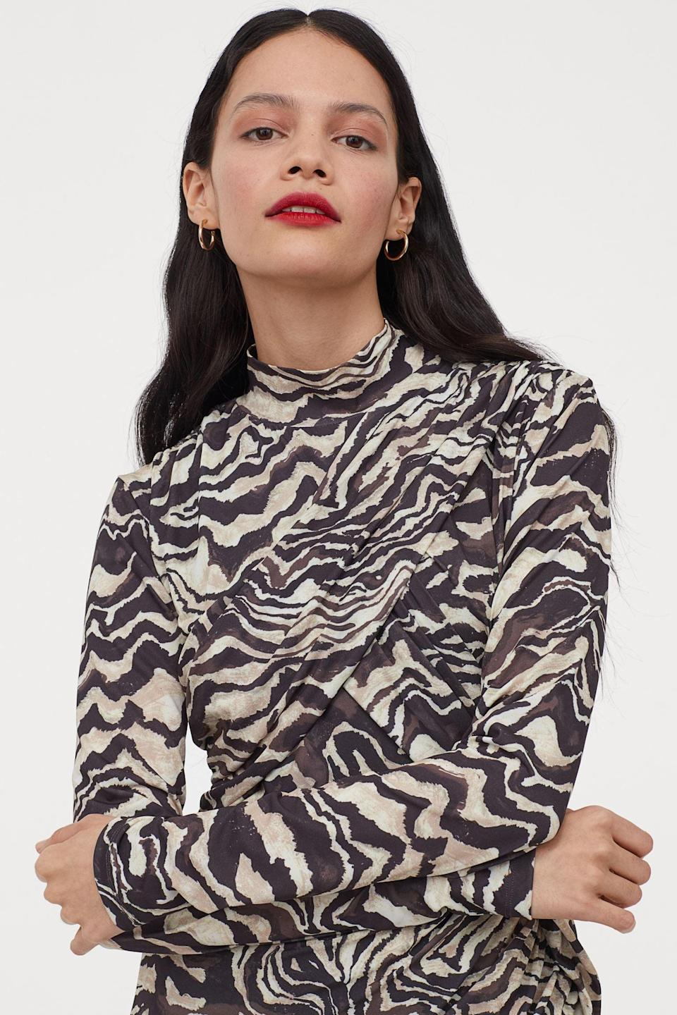 <p>If you love animal prints, this <span>Draped Dress</span> ($26, originally $50) was made for you.</p>