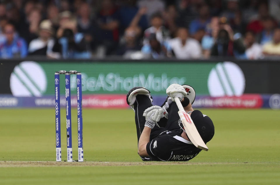 New Zealand's Henry Nicholls dives on the ground in an attempt to make it to the crease. (AP Photo/Aijaz Rahi)