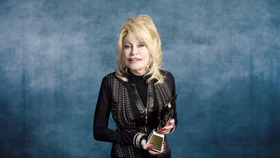 UNSPECIFIED - DECEMBER 10: In this screengrab released on December 10, Dolly Parton accepts the Hitmaker Award during the Billboard Women In Music 2020 event on December 10, 2020. (Photo by 2020 Billboard Women In Music/Getty Images for Billboard)