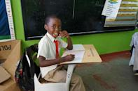 A pupil at Lighthouse Christian Academy in Atkinson, where electricity was yet to be restored