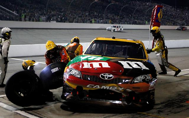 RICHMOND, VA - APRIL 28: Kyle Busch, driver of the #18 M&M's Ms. Brown Toyota, pits during the NASCAR Sprint Cup Series Capital City 400 at Richmond International Raceway on April 28, 2012 in Richmond, Virginia. (Photo by Jeff Zelevansky/Getty Images for NASCAR)