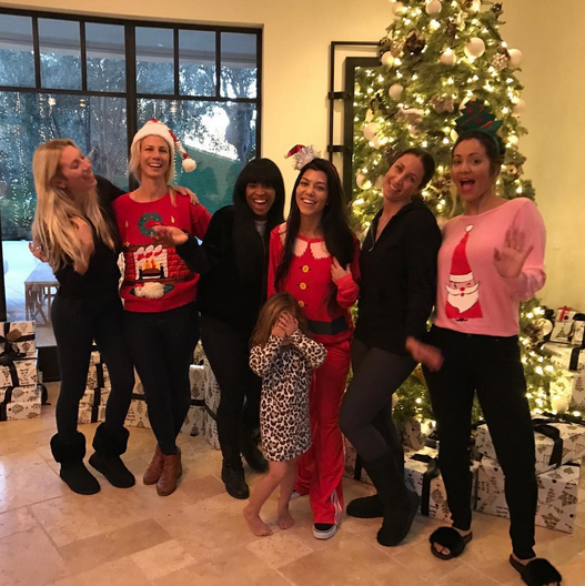 """<p>Looks like little Penelope Disick was embarrassed by mom Kourtney Kardashian's Santa top and red track pants! The reality stars gathered with a group of gal pals on Christmas Eve. """"Some of us are more festive than others,"""" quipped Kourtney. """"Merry Christmas Eve!"""" (Photo: <a rel=""""nofollow noopener"""" href=""""https://www.instagram.com/p/BOa8zqkA8bB/"""" target=""""_blank"""" data-ylk=""""slk:Instagram"""" class=""""link rapid-noclick-resp"""">Instagram</a>) </p>"""