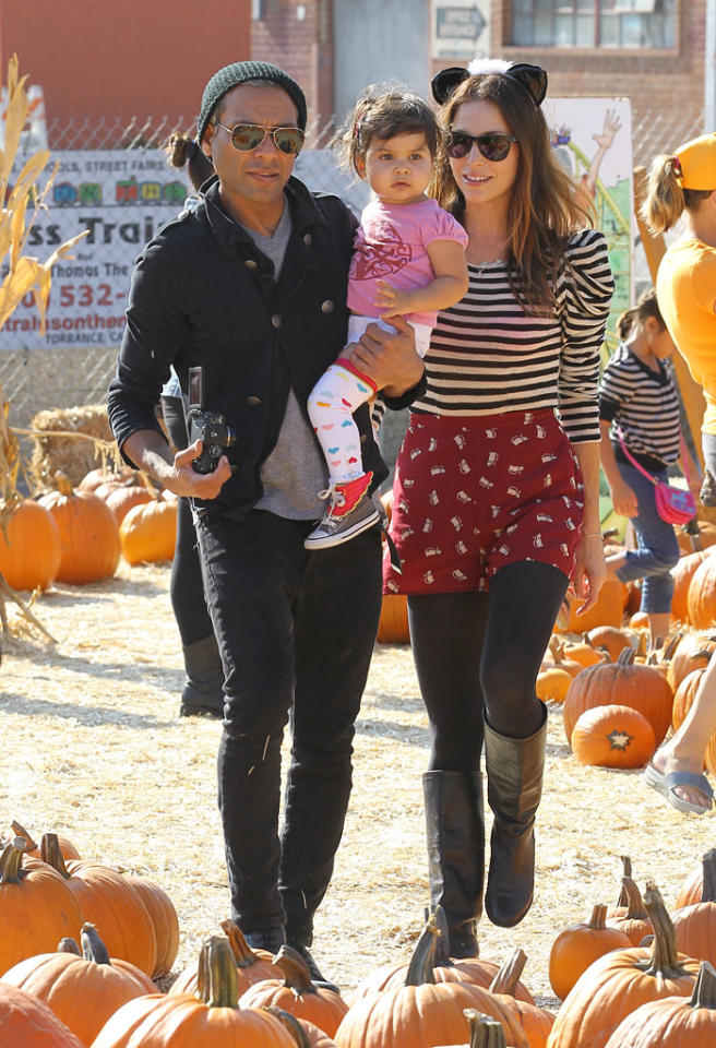Tony Kanal and his wife Erin Lokitz take their daughter Coco to Shawn's Pumpkin Patch in Los Angeles, CA. Pictured: Tony Kanal, Erin Lokitz and Coco Reese Lakshmi Kanal  Ref: SPL449935  211012  Picture by: Gio / Splash News   Splash News and Pictures Los Angeles:310-821-2666 New York:212-619-2666 London:870-934-2666 photodesk@splashnews.com