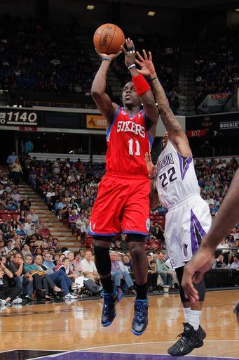 SACRAMENTO, CA - MARCH 24: Jrue Holiday #11 of the Philadelphia 76ers shoots in the lane against Isaiah Thomas #22 of the Sacramento Kings on March 24, 2013 at Sleep Train Arena in Sacramento, California. (Photo by Rocky Widner/NBAE via Getty Images)