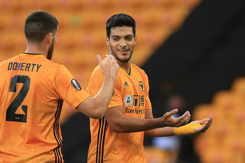 Wolverhampton Wanderers' Mexican striker Raul Jimenez celebrates scoring the opening goal during the UEFA Europa League round of 16 second leg football match between Wolverhampton Wanderers and Olympiakos at the Molineux stadium in Wolverhampton, central England on August 6, 2020. (Photo by Lindsey Parnaby / AFP) (Photo by LINDSEY PARNABY/AFP via Getty Images)