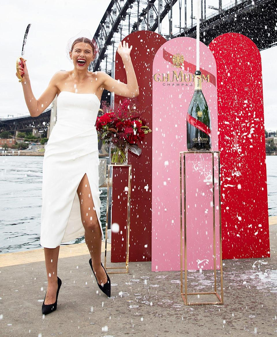 <p>Model Georgia Fowler sabers a bottle of G.H. Mumm Champagne at the launch of their Melbourne Cup Carnival celebrations on Wednesday in Sydney. </p>