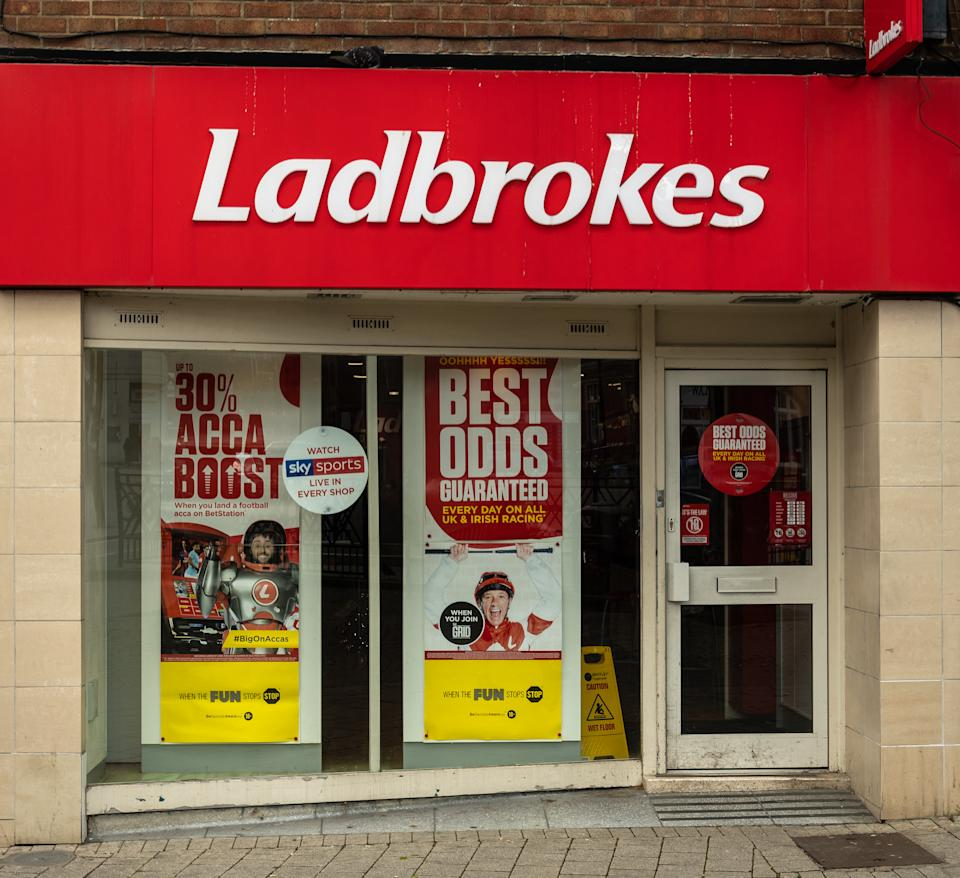 The entrance to Ladbrokes Bookmakers in Regent Street, Swindon, UK. Credit: Getty.