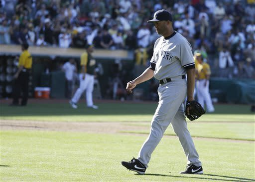 New York Yankees' Mariano Rivera walks off the field after giving up the game winning run in the 18th inning of a baseball game against the Oakland Athletics Thursday, June 13, 2013 in Oakland, Calif. Oakland won game 3-2, after the A's Nate Freiman drive in the game-winning run off Rivera. (AP Photo/Eric Risberg)