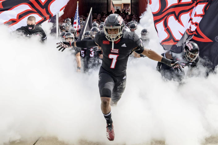 Louisiana-Lafayette linebacker Ferrod Gardner (7) enters the field with Louisiana-Lafayette head coach Billy Napier before an NCAA college football game against South Alabama in Lafayette, La., Saturday, Nov. 14, 2020. (AP Photo/Matthew Hinton)