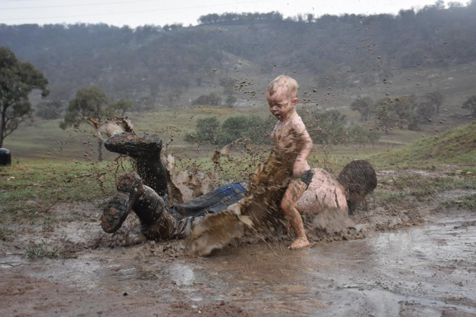 NSW boy Archie Saunders experiences the largest rainfall of his life with his dad.