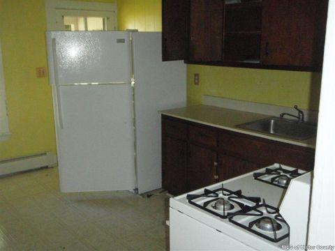 """<div class=""""caption""""> <strong>BEFORE</strong>: """"It was a mess,"""" Maryline says, of the crowded kitchen layout before, """"practically everything had been crammed onto one wall of the kitchen."""" </div>"""