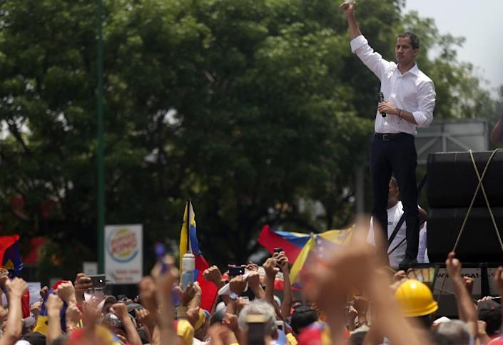 Venezuelan opposition leader Juan Guaido called on the military to dump President Nicolas Maduro but protests fizzled out, with no sign of his allies -- and above all the army -- breaking ranks (AFP Photo/Cristian HERNANDEZ)