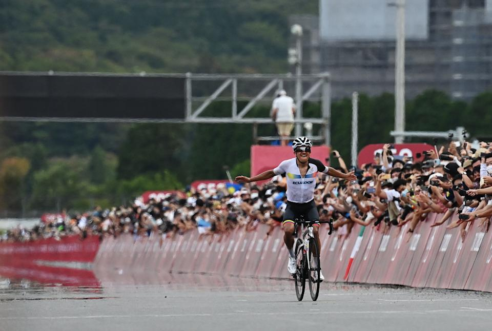 Ecuador's Richard Carapaz celebrates as he rides to the finish line to win the men's cycling road race during the Tokyo 2020 Olympic Games at the Fuji International Speedway in Oyama, Japan, on July 24, 2021. (Photo by Greg Baker / AFP) (Photo by GREG BAKER/AFP via Getty Images)