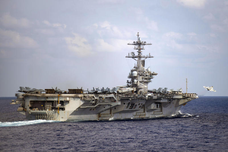 In this March 18, 2020, photo provided by the U.S. Navy, an F/A-18F Super Hornet launches from the flight deck of the aircraft carrier USS Theodore Roosevelt (CVN 71) in the western North Pacific Ocean. The Navy's top admiral will soon decide the fate of the ship captain who was fired after pleading for his superiors to move faster to safeguard his coronavirus-infected crew on the USS Theodore Roosevelt. (Mass Communication Specialist 3rd Class Nicholas V. Huynh/U.S. Navy via AP))