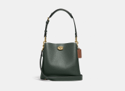 """<p><strong>Coach</strong></p><p>coach.com</p><p><a href=""""https://go.redirectingat.com?id=74968X1596630&url=https%3A%2F%2Fwww.coach.com%2Fproducts%2Fwillow-bucket-bag-in-colorblock%2FC3766.html&sref=https%3A%2F%2Fwww.elle.com%2Ffashion%2Fshopping%2Fg37779639%2Fcoach-sale-bags-2021%2F"""" rel=""""nofollow noopener"""" target=""""_blank"""" data-ylk=""""slk:Shop Now"""" class=""""link rapid-noclick-resp"""">Shop Now</a></p><p><strong><del><del>$295</del></del> $221.25 (20% off with code SAVENOW) </strong></p><p>We'll take two of this classic bucket bag. </p>"""
