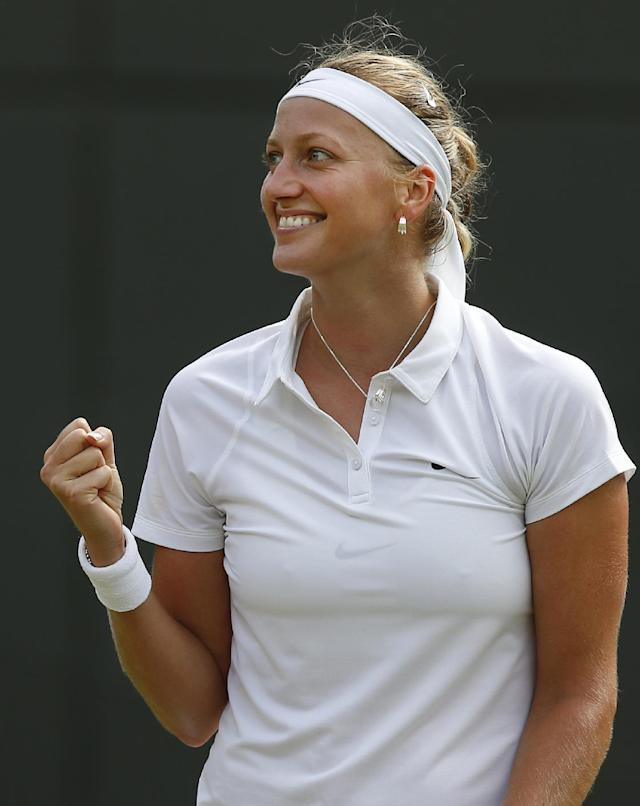 Petra Kvitova of the Czech Republic celebrates winning during her women's singles match against Mona Barthel of Germany at the All England Lawn Tennis Championships in Wimbledon, London, Wednesday, June 25, 2014. (AP Photo/Sang Tan)
