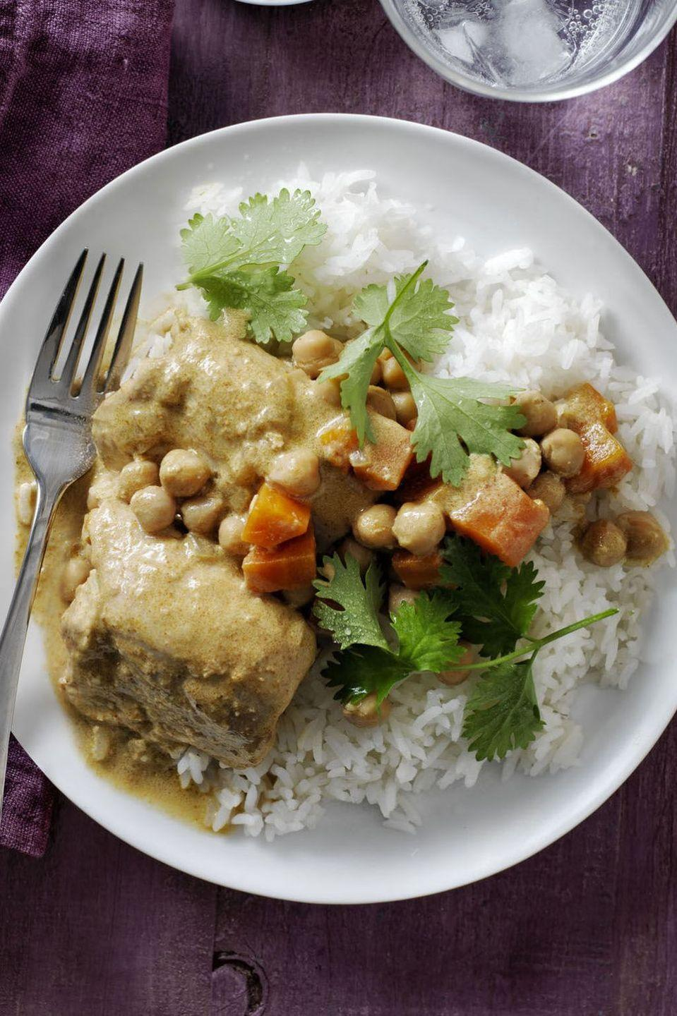 """<p>This recipe combines spicy and sweet in the most delightful way. This is thanks to the blend of cayenne pepper, curry, and coconut milk. One tip: If you buy coconut milk in a can, try to get a brand that doesn't use preservatives.</p><p><em><a href=""""https://www.womansday.com/food-recipes/food-drinks/recipes/a57921/coconut-curry-chicken-chickpeas-recipe/"""" rel=""""nofollow noopener"""" target=""""_blank"""" data-ylk=""""slk:Get the recipe from Woman's Day »"""" class=""""link rapid-noclick-resp"""">Get the recipe from Woman's Day »</a></em></p>"""