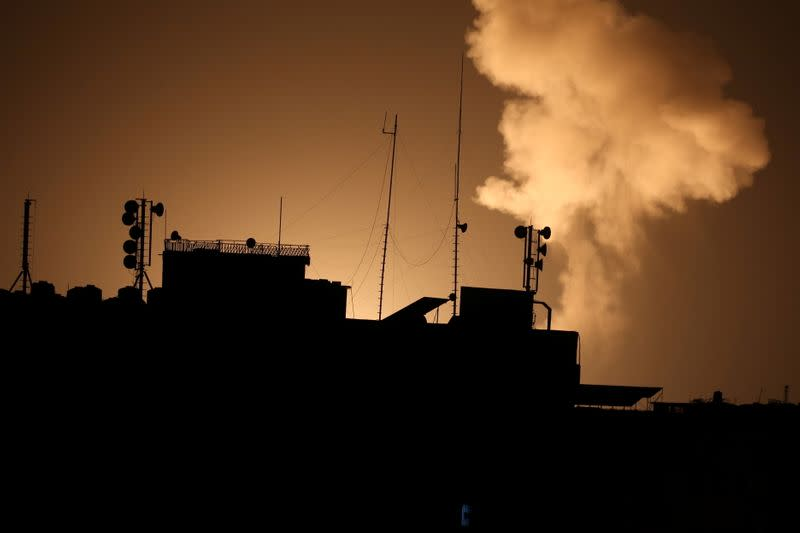 Smoke rises following an Israeli air strike in Gaza Strip