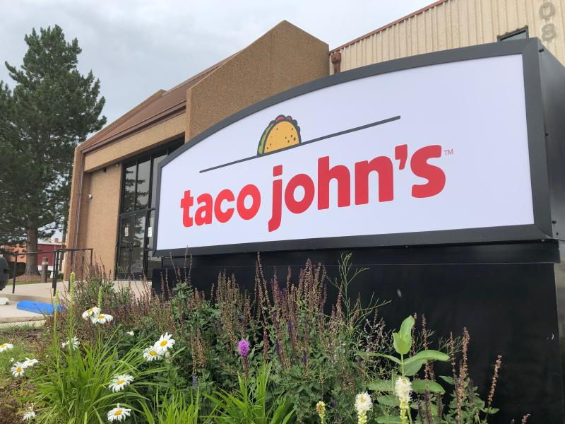 "In this Aug. 1, 2019 photo the corporate headquarters of Cheyenne-based Taco John's, which has nearly 400 locations in 23 states, is seen in Cheyenne, Wyo. Taco John's recently sent Freedom's Edge Brewing Co. in Cheyenne a cease-and-desist letter for using ""Taco Tuesday"" to advertise the taco truck parked outside on Tuesdays. Taco John's has owned the trademark to ""Taco Tuesday"" since 1989 and calls the term part of its ""DNA."" Some say the term has become so common that Taco John's can't legitimately continue to claim it. (AP Photo/Mead Gruver)"