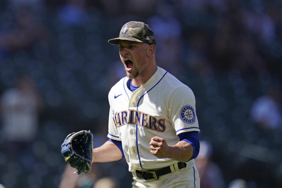 Seattle Mariners relief pitcher Anthony Misiewicz lets out a yell and pumps a fist after a double play with bases loaded ended the top of the seventh inning of a baseball game against the Cleveland Indians Sunday, May 16, 2021, in Seattle. (AP Photo/Elaine Thompson)