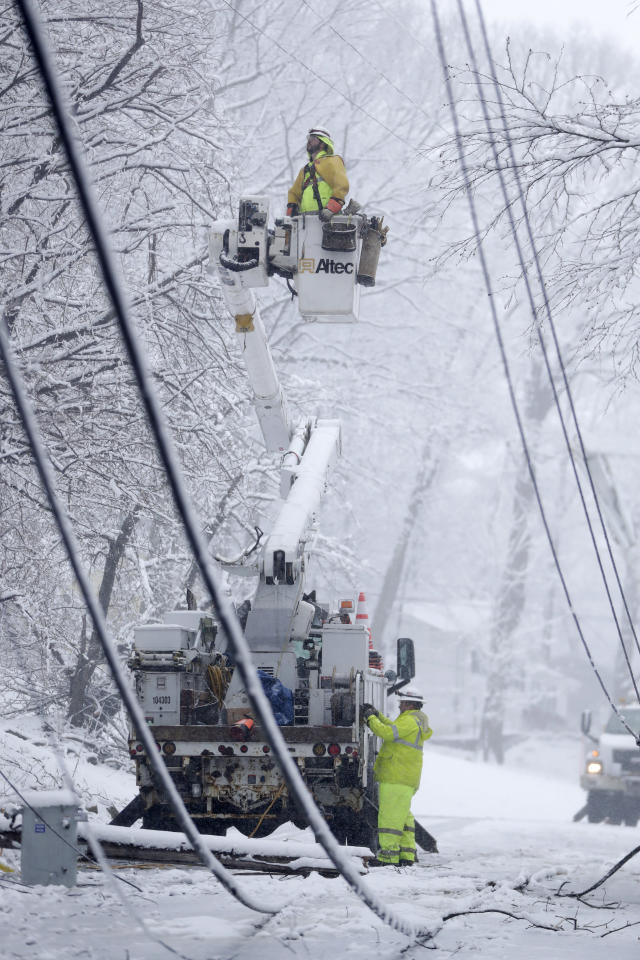 <p>Utility workers use a bucket truck to repair downed power lines along Mountainside Drive on March 7, 2018, in Morristown, N.J. Residents saw a second storm after last week's storm downed trees and power lines. (Photo: Julio Cortez/AP) </p>