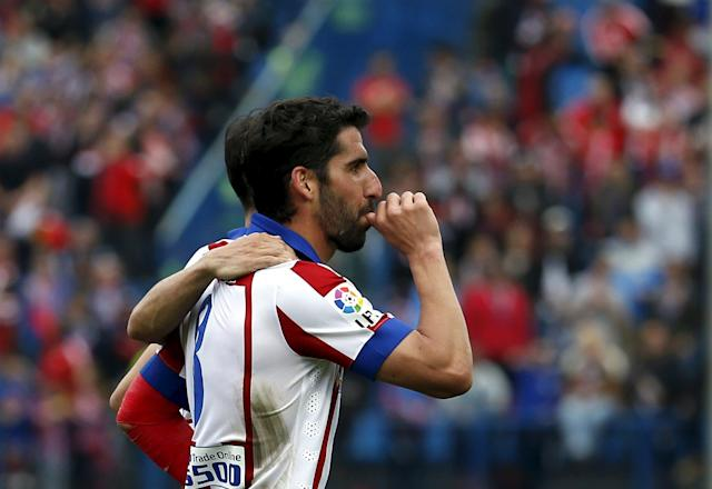 Atletico Madrid's Raul Garcia celebrates scoring against Elche during their Spanish first division soccer match at Vicente Calderon stadium in Madrid, April 25, 2015. REUTERS/Susana Vera