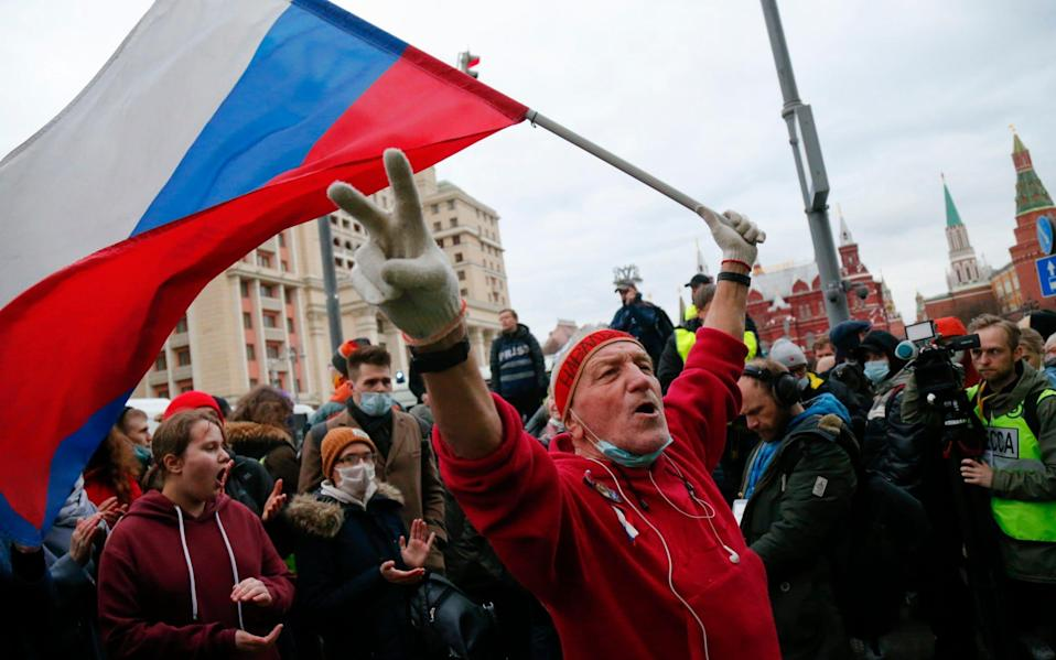 A supporter waves a Russian flag and shouts slogans during the opposition rally in support of jailed opposition leader Alexei Navalny in Moscow - Alexander Zemlianichenko /AP