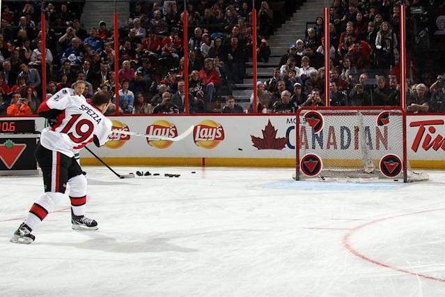 OTTAWA, ON - JANUARY 28: Jason Spezza #19 of the Ottawa Senators and team Alfredsson takes a shot during the Canadian Tire NHL Accuracy Shooting part of the 2012 Molson Canadian NHL All-Star Skills Competition at Scotiabank Place on January 28, 2012 in Ottawa, Ontario, Canada. (Photo by Bruce Bennett/Getty Images)