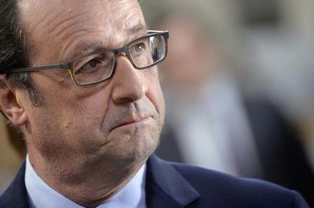 French President Francois Hollande visits the French clothing brand Wrung in L'Hay-Les-Roses