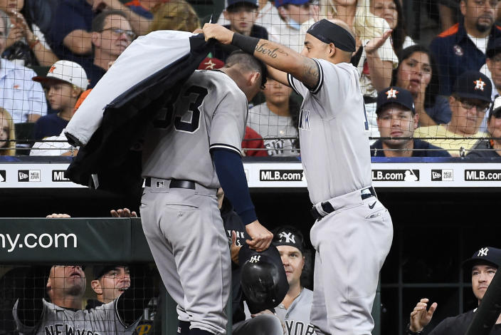 New York Yankees' Rougned Odor, right, puts a jacket on Tim Locastro after Locastro hit a solo home run during the fourth inning of a baseball game against the Houston Astros, Sunday, July 11, 2021, in Houston. (AP Photo/Eric Christian Smith)