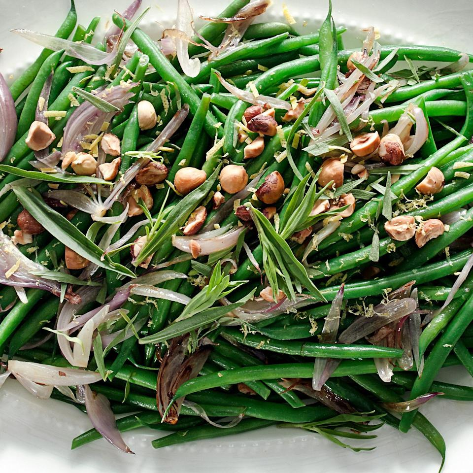 "This green bean recipe relies on an ingenious French technique that works well with plenty of vegetables: Cook the beans in a mixture of water and butter. The water will eventually cook off after steaming the veg, leaving behind a silky, buttery glaze. <a href=""https://www.epicurious.com/recipes/food/views/green-beans-with-shallots-hazelnuts-and-tarragon-51252890?mbid=synd_yahoo_rss"" rel=""nofollow noopener"" target=""_blank"" data-ylk=""slk:See recipe."" class=""link rapid-noclick-resp"">See recipe.</a>"