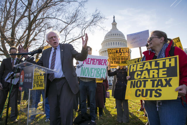 <p>Sen. Bernie Sanders joins protesters outside the Capitol as Republicans in the Senate work to pass their sweeping tax bill, a blend of generous tax cuts for businesses and more modest tax cuts for families and individuals, on Capitol Hill in Washington, Thursday, Nov. 30, 2017. (Photo: J. Scott Applewhite/AP) </p>