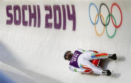 India's Keshavan speeds down the ice track during the men's luge training at the Sanki sliding center in Rosa Khutor, a venue for the Sochi 2014 Winter Olympics near Sochi