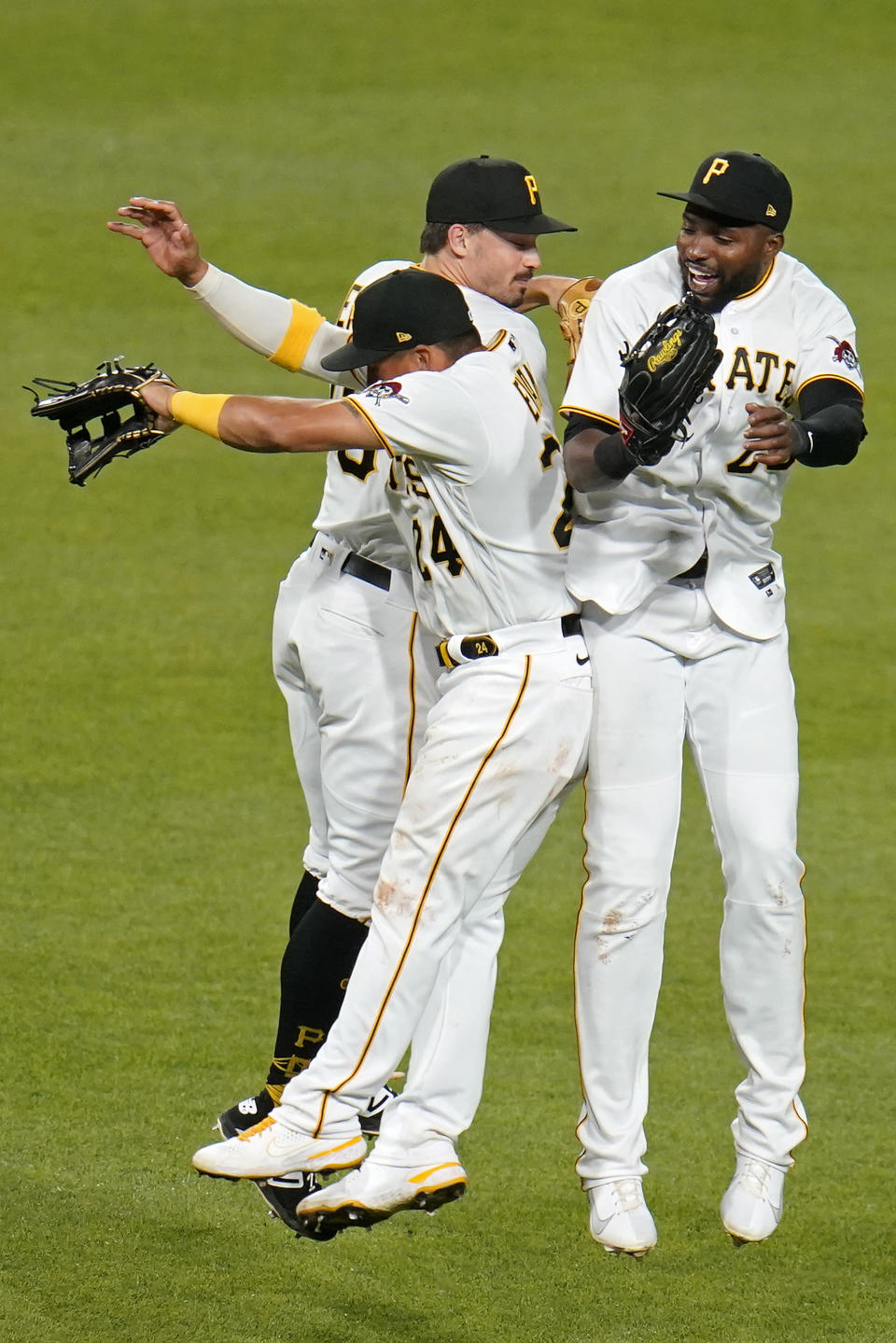 Pittsburgh Pirates outfielders Phillip Evans (24), Bryan Reynolds, center rear, and Gregory Polanco, right, celebrate after getting the final out of a baseball game against the Chicago White Sox in Pittsburgh, Tuesday, June 22, 2021. The Pirates won 6-3. (AP Photo/Gene J. Puskar)