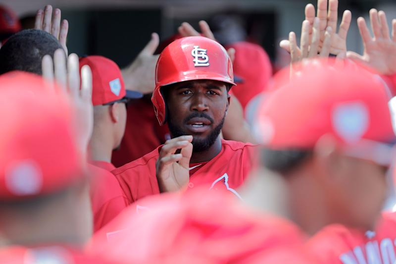 St. Louis Cardinals' Dexter Fowler celebrates after he scored in the third inning during an exhibition spring training baseball game against the Washington Nationals on Monday, March 11, 2019, in Jupiter, Fla. (AP Photo/Brynn Anderson)