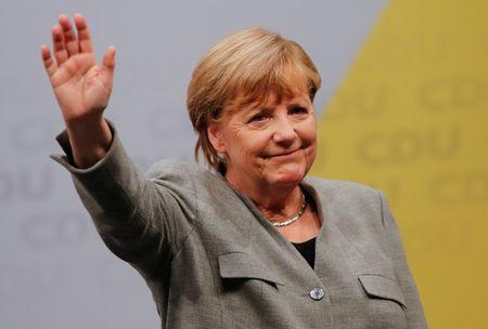 Angela Merkel, German Chancellor and leader of the conservative Christian Democratic Union (CDU) party waves following the start of the CDU's election rally for Germany's general election in Dortmund, Germany August 12, 2017. REUTERS/Wolfgang Rattay