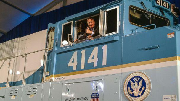 PHOTO: Former President George H.W. Bush gives a thumbs-up from the cab of Union Pacific Locomotive No. 4141 at its unveiling in 2005. (Courtesy Union Pacific)