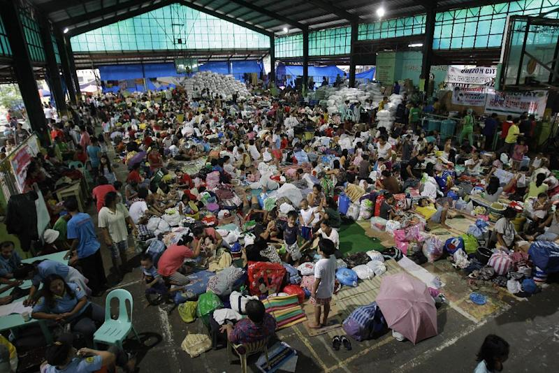 Flood victims stay inside a crowded basketball court that has converted into a temporary evacuation center in Quezon city, north of Manila, Philippines on Thursday Aug. 9, 2012. Over 2 million people were affected by Manila's worst flooding since 2009 as more than half of the sprawling metropolis of 12 million was submerged at the peak, and schools and offices have been closed for days. (AP Photo/Aaron Favila)