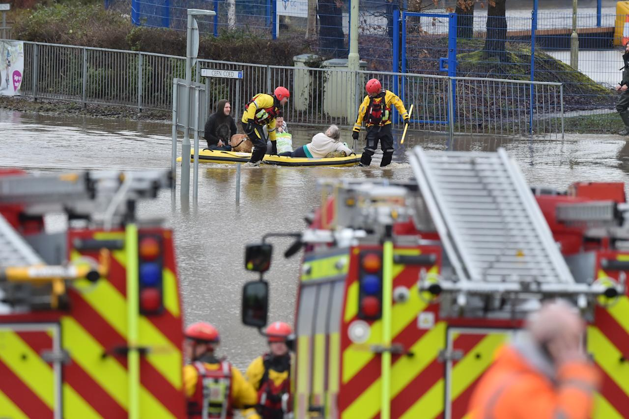 People continue to be rescued by emergency services after flooding in Nantgarw, Wales. (PA)