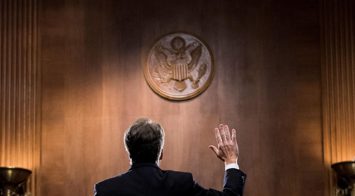 Kavanaugh is sworn in before testifying.