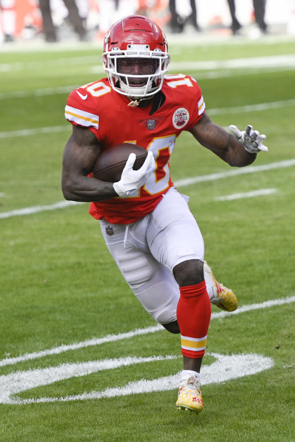 FILE - In this Jan. 17, 2021, file photo, Kansas City Chiefs wide receiver Tyreek Hill (10) runs against the Cleveland Browns during the NFL divisional round football game in Kansas City, Mo. Hill wants to be the Super Bowl halftime show. Hill said Monday, Feb. 1, 2021, hed be willing to race Tampa Bay receiver Scotty Miller during intermission at Raymond James Stadium on Sunday. (AP Photo/Reed Hoffmann, File)