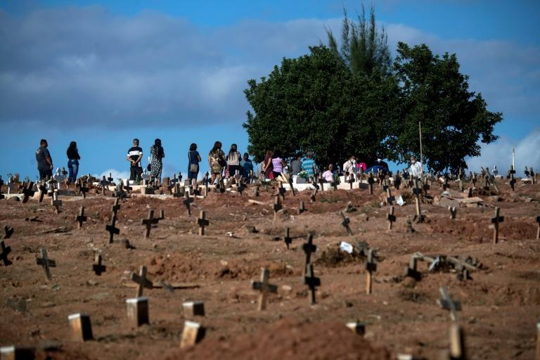 People attend a funeral at the Sao Franciso Xavier Cemetery in Rio de Janeiro in April 2021, amid the Covid-19 pandemic