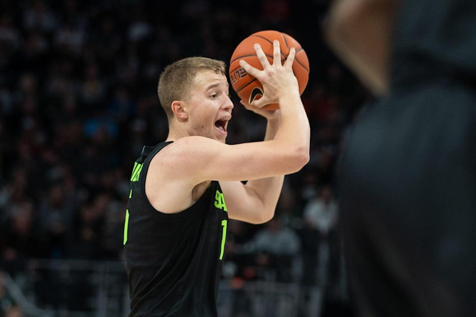 Michigan State forward Thomas Kithier looks for an open pass during the first half on Saturday, Dec. 14, 2019, at Little Caesars Arena.