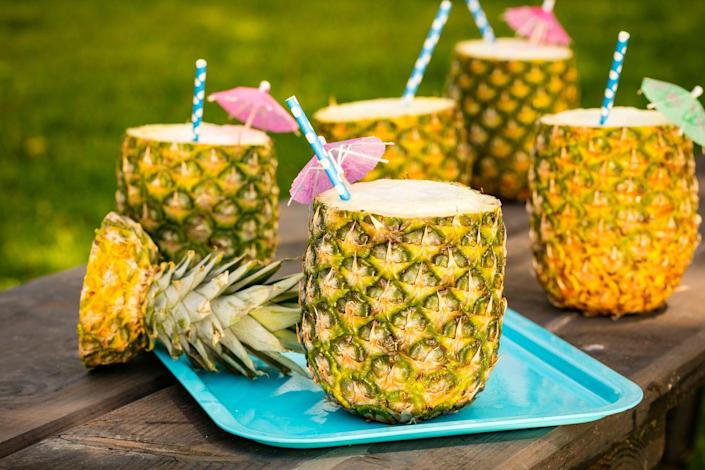 """<p>You won't mind getting lost in the rain when you're sipping one of these.</p><p>Get the recipe from <a href=""""https://www.delish.com/cooking/videos/a47265/how-to-make-pineapple-cups/"""" rel=""""nofollow noopener"""" target=""""_blank"""" data-ylk=""""slk:Delish"""" class=""""link rapid-noclick-resp"""">Delish</a>.</p>"""