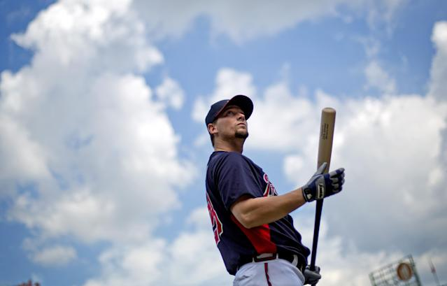 Atlanta Braves' Chris Johnson waits to take baseball batting practice on Wednesday, Oct. 2, 2013, in Atlanta. The Los Angeles Dodgers are to play the Braves in Game 1 of the National League Division Series in Atlanta, Thursday. (AP Photo/David Goldman)