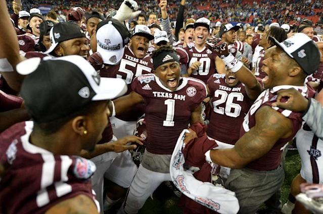 Texas A&M celebrates their win over Duke in the Chick-fil-A Bowl Tuesday Dec. 31, 2013, in Atlanta. (AP Photo/Atlanta Journal-Constitution, Brant Sanderlin) MARIETTA DAILY OUT; GWINNETT DAILY POST OUT; LOCAL TV OUT; WXIA-TV OUT; WGCL-TV OUT MBI (REV-SHARE)
