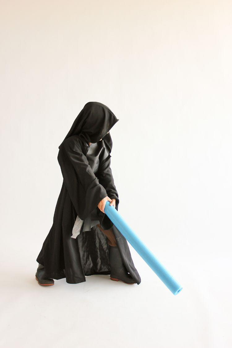"""<p>Jut a little black pleather, an easy-to-make hooded robe, and thermal pjs can transform your kid into the most tragic figure in the <em>Star Wars </em>universe. </p><p><strong>Get the tutorial at <a href=""""https://www.deliacreates.com/star-wars-obi-wan-costume-tutorial/"""" rel=""""nofollow noopener"""" target=""""_blank"""" data-ylk=""""slk:Delia Creates"""" class=""""link rapid-noclick-resp"""">Delia Creates</a>.</strong> </p>"""