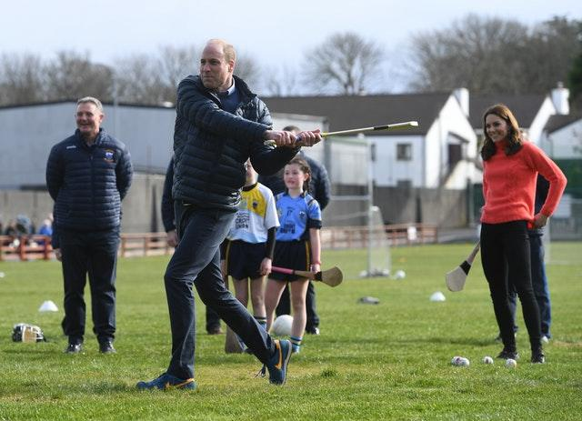 The Duke of Cambridge tries his hand at hurling at Salthill Knocknacarra GAA Club in Galway