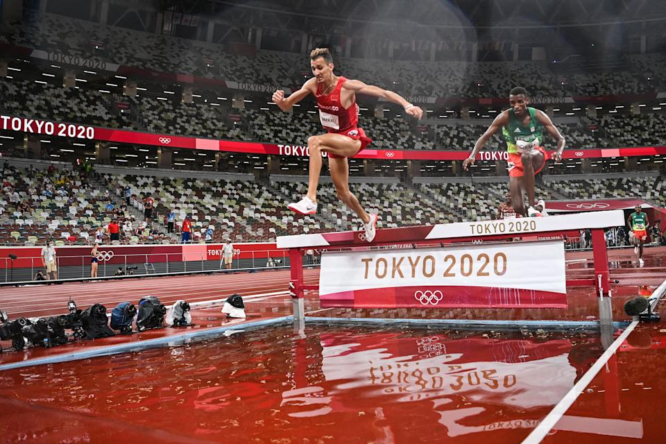 <p>TOPSHOT - Morocco's Soufiane El Bakkali (L) and Ethiopia's Lamecha Girma compete in the men's 3000m steeplechase final during the Tokyo 2020 Olympic Games at the Olympic Stadium in Tokyo on August 2, 2021. (Photo by Andrej ISAKOVIC / AFP) (Photo by ANDREJ ISAKOVIC/AFP via Getty Images)</p>