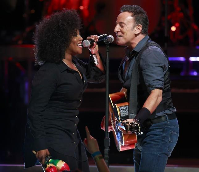 VANCOUVER, CANADA - NOVEMBER 26: Bruce Springsteen (R) performs with Cindy Mizelle at Rogers Arena.